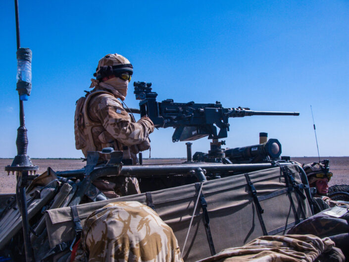 British soldier manning a vehicle mounted 50cal in the Afghanistan desert outside Marjah, Helmand
