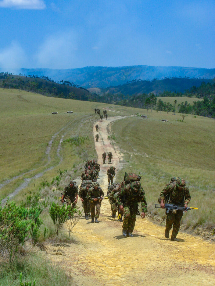 British Army soldiers marching in the midday heat through the jungles in Belize