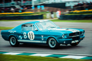 Ford Mustang Shelby GT350 marked B11 with crowd in the background