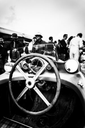 Mercedes Benz W196 empty cockpit and steering wheel with crowd mingling in the background