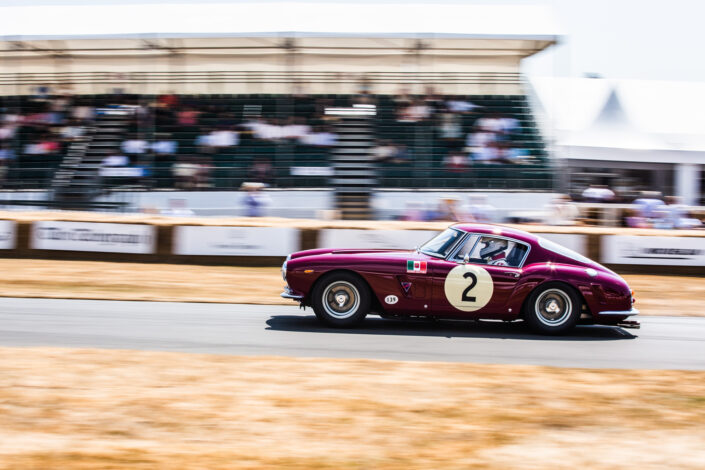 Ferrari 250 GT SWB Berlinetta on the track with the grandstand in the background